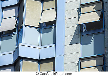 frente, fachada, de, un, contemporáneo, azul, edificio de oficinas, con, windows