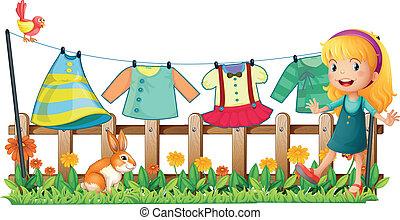 frente, niña, ropa, jardín, ahorcadura