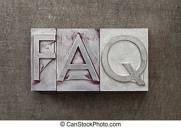 FAQ (frequently asked questions) acronym - text in vintage letterpress metal type against a grunge steel sheet