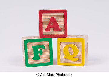Wooden Alphabet Blocks spelling FAQ the commonly used abbreviation of Frequently asked questions