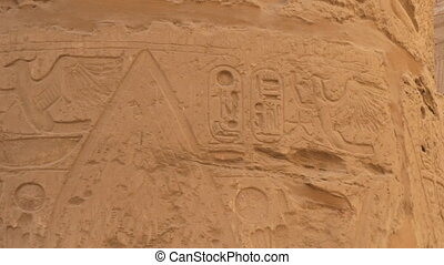 Panorama of a Column on Which Various Symbols of Ancient Egypt Are Represented. There is a Symbol of a Lotus Flower Carved on the Stone Wall.