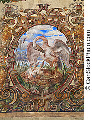 fresco with stork nest on medieval building