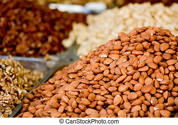 Fresh Almonds and dry fruits on display in food market in...