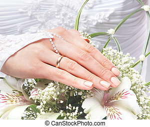 Fresh and beautiful wedding bouquet in bride's hands
