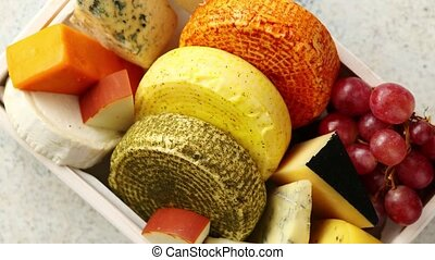 Fresh and delicious different kinds of cheeses placed in...