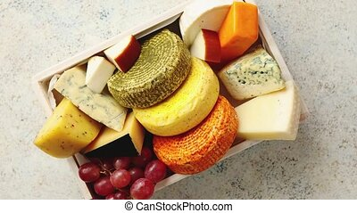 Fresh and delicious different kinds of cheeses placed in ...