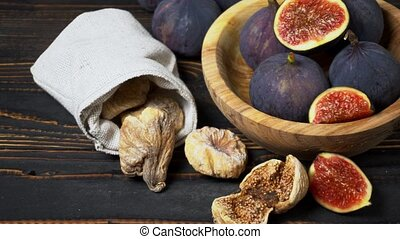 Fresh and dried Fig isolated on wooden background - Fresh...