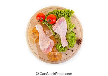 Fresh and frozen chicken legs with vegetables