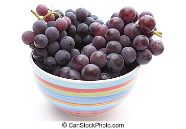 Fresh and natural grapes in a bowl on white background