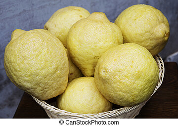 fresh and organic citrons in a basket