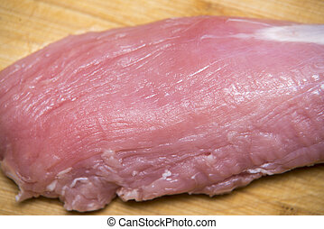 Fresh and raw meat. Sirloin on wood background
