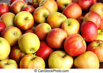 Fresh and ripe apples background, close up
