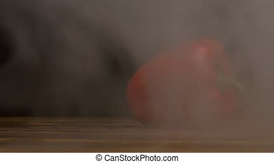 Fresh and ripe Bulgarian pepper on a black background in a...