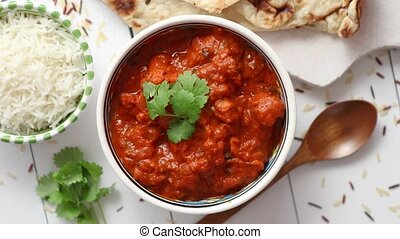 Fresh and tasty Chicken tikka masala served in ceramic bowl....