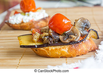 Fresh and tasty crostini with the eggplants, mushrooms and cherry tomato
