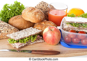 Fresh and tasty ingredients prepared for lunch on wooden board