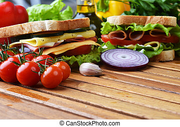 tasty sandwich - Fresh and tasty sandwich on wooden cutting...