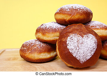fresh and warm doughnuts on yellow background
