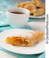 Fresh Apfelstrudel on a plate with blue towel