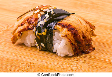 Fresh appetizing seafood sushi on wooden table.