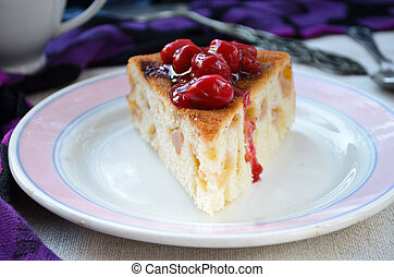 fresh apple charlotte cake with cherries in plate