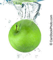 fresh apple falling in water