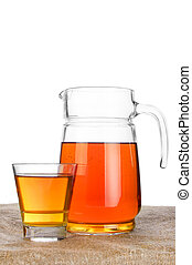 Fresh apple juice in glass jar on table with linen tablecloth