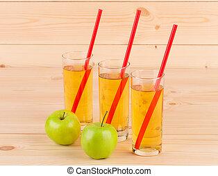 Fresh apple juice on wood.