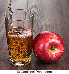 fresh apple juice pouring into glass