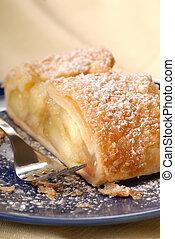 Fresh apple strudel with powdered sugar - Freshly baked...