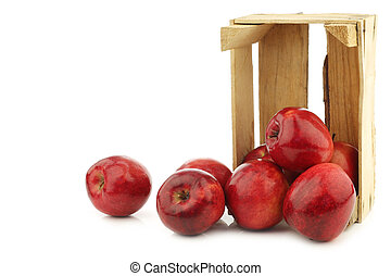 "Fresh apples called ""red love"" in a wooden crate"