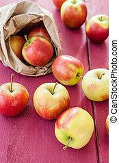 Fresh apples - Fresh ripe apples in paper bag on wooden ...