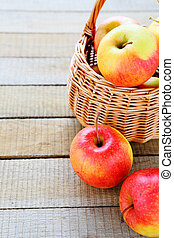 fresh apples in a wicker basket