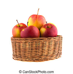 Fresh apples in a wicker basket, isolated on white background.