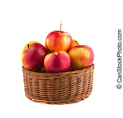 Fresh Apples in a wooden basket, isolated on white background.