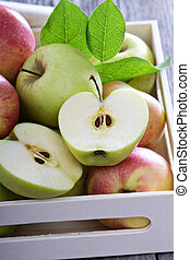 Fresh apples in a wooden box