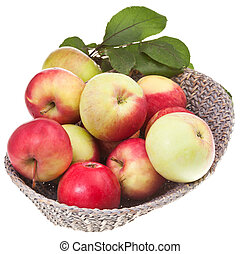 fresh apples in straw basket isolated on white