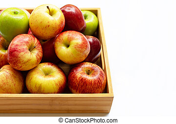 Fresh apples in wooden box on white background.