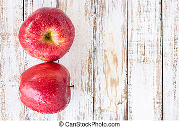 Fresh apples on a wooden table
