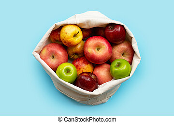 Fresh apples on blue background. Top view