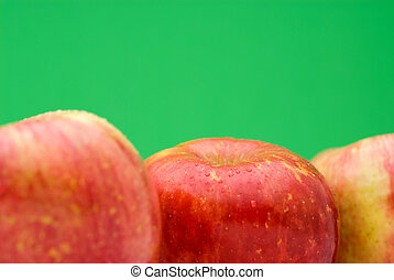Fresh apples on bright green