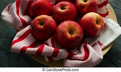 Fresh apples on striped towel - From above red ripe whole...
