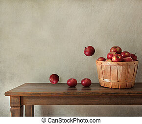 Fresh apples on wooden table
