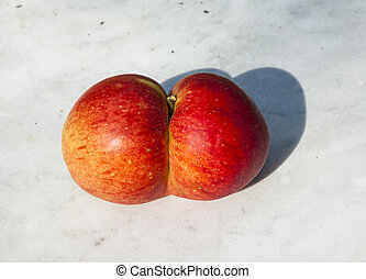 fresh apples with funny deformations like double egg
