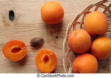 Fresh apricot fruits on a wooden table