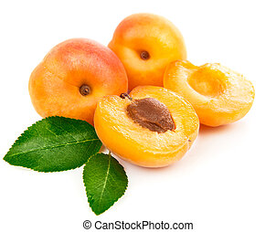 Fresh apricots in section with green leaves