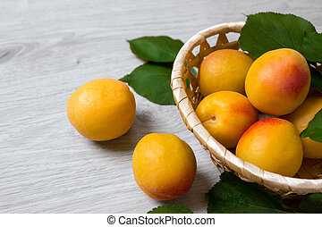 Fresh apricots in the basket On a wooden table