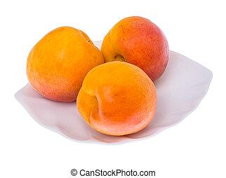Fresh apricots isolated on white background