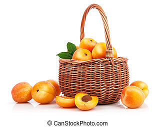 Fresh apricots with green leaf in wicker