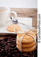 fresh aromatic coffee and cookies on table